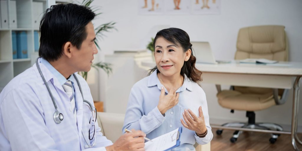 An elderly patient talking to her doctor about her concerns